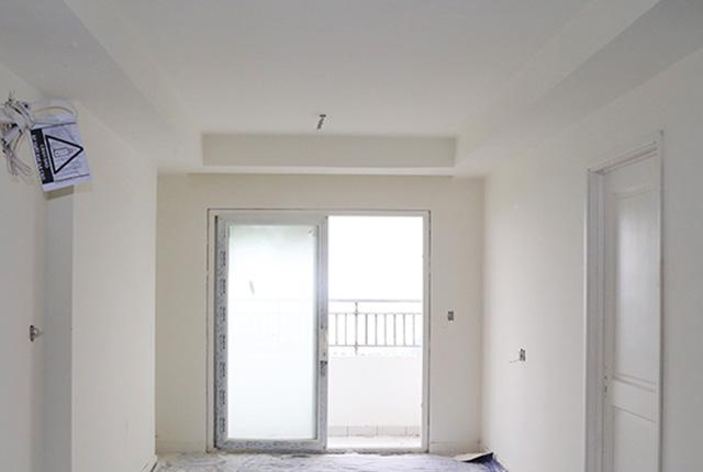 Tiếp tục bả sơn matit căn hộ tầng 18 Block A và tầng 21 Block B