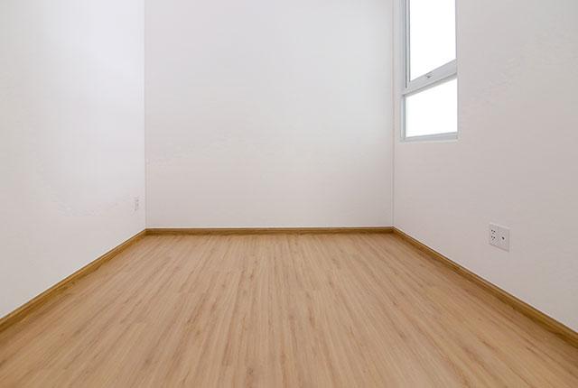 Ốp sàn gỗ phòng ngủ căn hộ tầng 17 block A, B