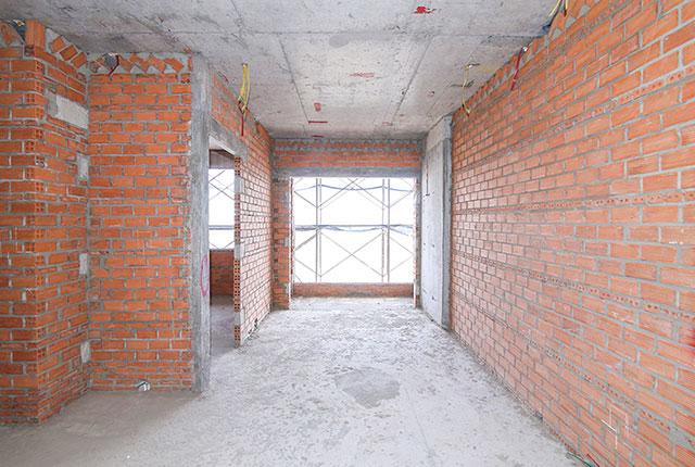 Thi công xây tường bao căn hộ tầng 21 block B